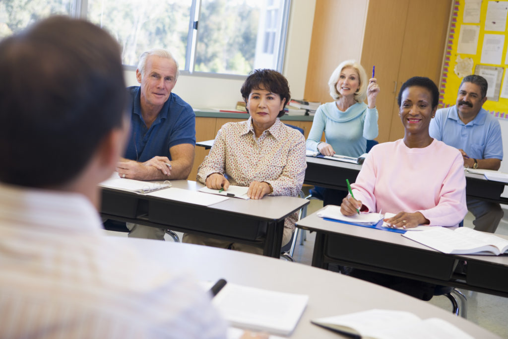 Diverse adult students learning in a classroom